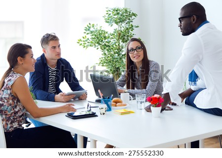 Portrait of team working in the office. - stock photo