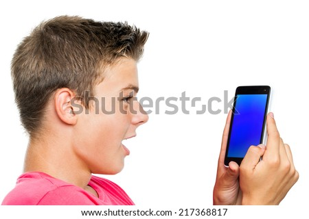 Portrait of Teen boy holding smart phone with surprised face expression.Isolated on white background.