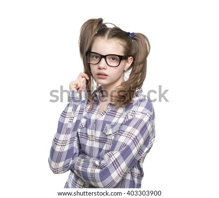 Portrait of teen girl in a plaid shirt.Studio photography on a white background. Age of child 11 years. - stock photo