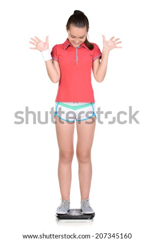 Portrait of teen girl laughing makes fitness, using weights, isolated on white - stock photo
