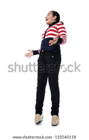 Portrait of teen girl standing against white background looking up - stock photo