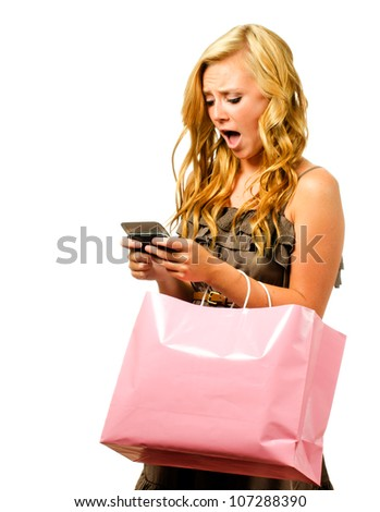 Portrait of teen girl with pink shopping bag texting with shocked or surprised expression isolated on white - stock photo