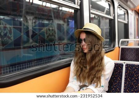 Portrait of teen in subway train, Istanbul, Turkey - stock photo