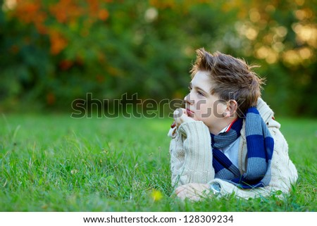 portrait of teenage boy, green  outdoors - stock photo