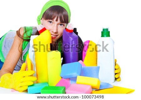 Portrait of teenage girl behind cleaning products - stock photo