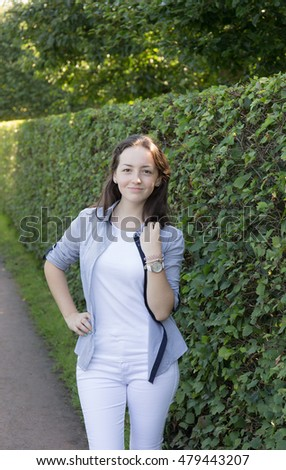 portrait of teenage girl in a summer park