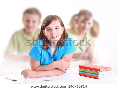 Portrait of teenage girl in classroom. - stock photo