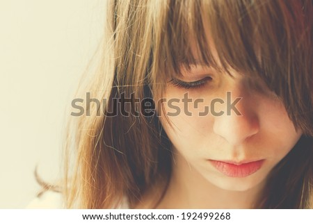 Portrait of Teenage Girl, looking sad, toning effect, closeup - stock photo