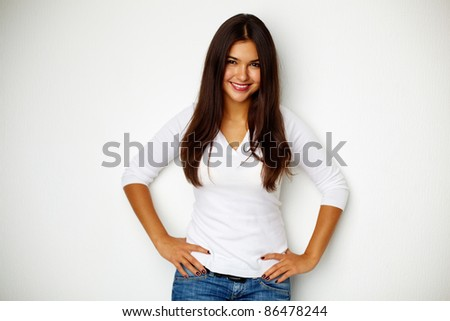 Portrait of teenage girl standing by the wall - stock photo