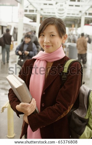 Portrait of teenage girl with books - stock photo