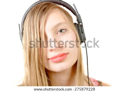 portrait of teenage girl with headphone on the white background