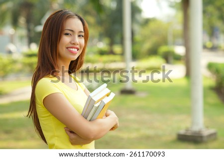 Portrait of teenage girl with textbooks