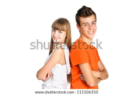 portrait of teenager boy and girl smiling isolated over white background - stock photo