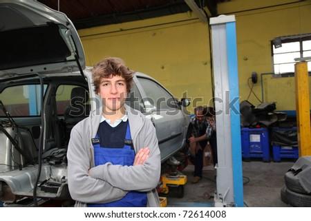 Portrait of teenager in mechanics apprenticeship - stock photo
