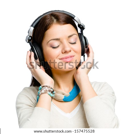 Portrait of teenager with eyes closed listening to music in earphones, isolated on white - stock photo