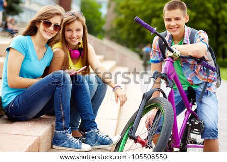 Portrait of teenagers enjoying life and themselves, urban environment - stock photo