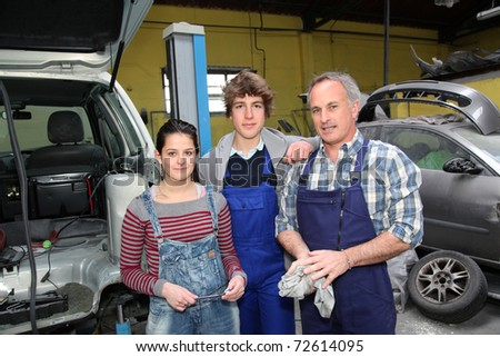 Portrait of teenagers in mechanics training course - stock photo