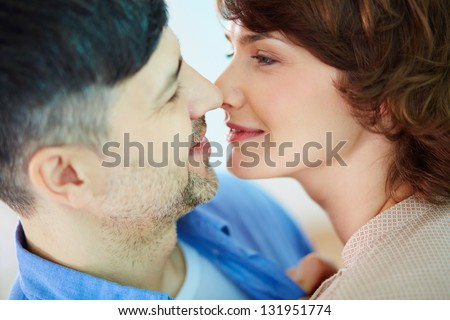 Portrait of tender couple looking at one another