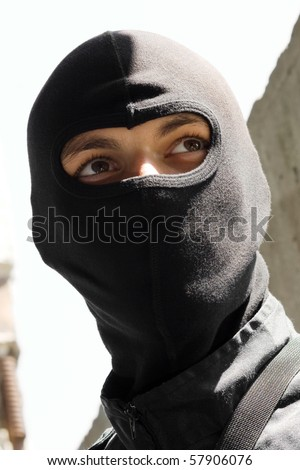 Portrait of terrorist in black mask. Unknown armed forces in Eastern Ukraine. Good guy or bad guy