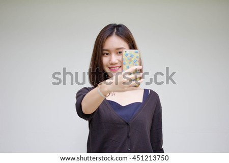 Portrait of thai adult student university beautiful girl using her smart phone Selfie