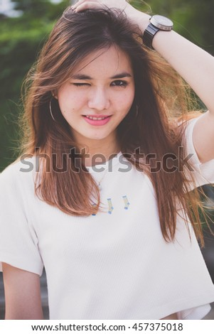 Portrait of thai chinese adult beautiful girl relax and smile