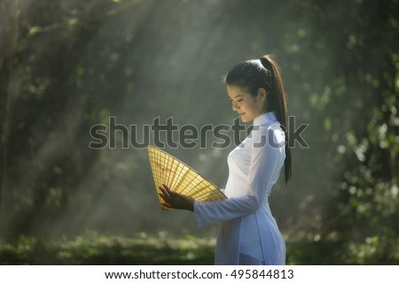 Portrait of Thai girls with Ao-Dai, Vietnam traditional dress.