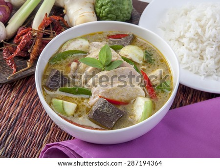 portrait of thai green curry served with rice