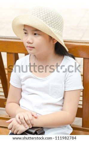 Portrait of Thai style girl in white dress, Thailand.