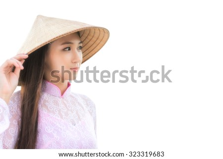 Portrait of Thai woman with Ao Dai on white background, Vietnam traditional dress, Ao dai is famous traditional costume for woman in Vietnam.