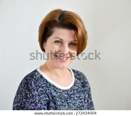 Portrait of the adult female on a light background - stock photo