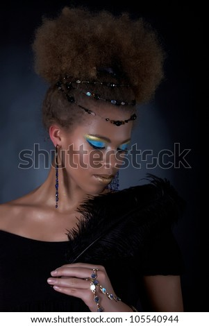 Portrait of the african model with feather - stock photo
