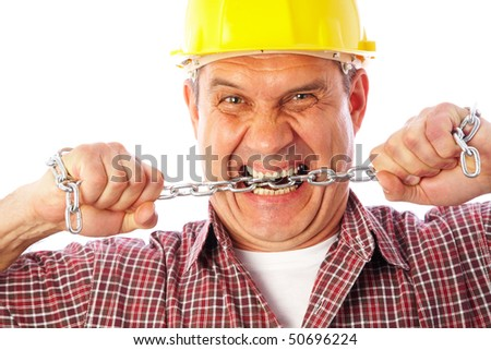Portrait of the angry builder who tries to break the metal chain - stock photo