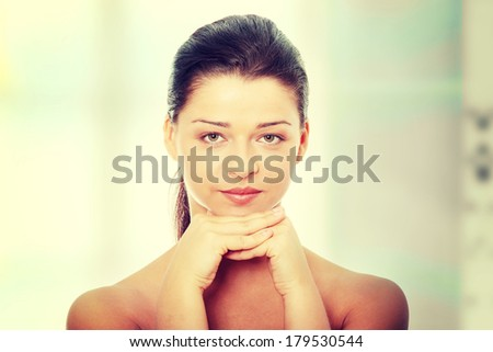 Portrait of the attractive girl without a make-up - stock photo