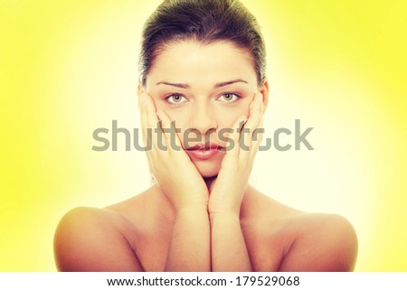 Portrait of the attractive girl without a make-up, over green background  - stock photo