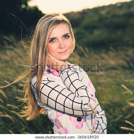 portrait of the attractive, slender, beautiful young Caucasian  blonde girl outdoor. Beautiful modern woman  with the long developing fair. Photo with instagram style filters - stock photo