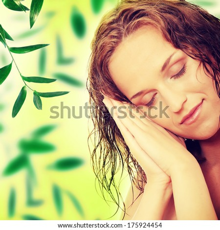 Portrait of the attractive woman without a make-up - stock photo