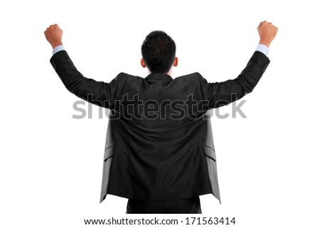 portrait of the back of business man with arms raised in success - stock photo