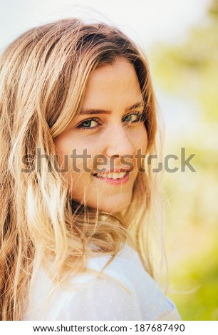 Portrait of the beautiful blond girl close-up, Beach fashion lifestyle.