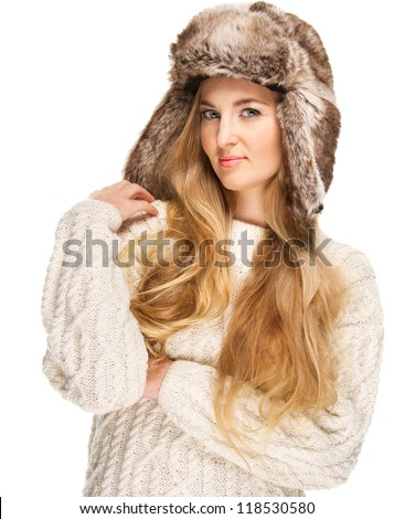 Portrait of the beautiful blond girl with curly hair in fur hat