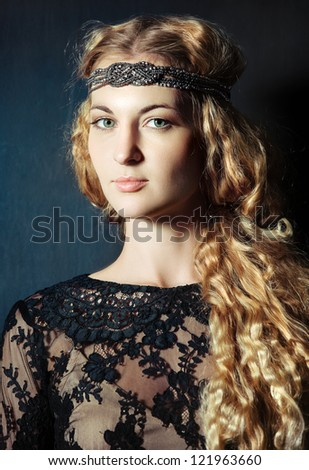 Portrait of the beautiful blond girl with hairdress - stock photo