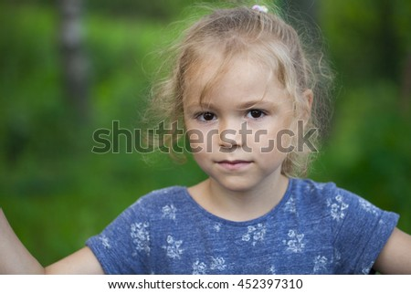 Portrait of the beautiful blonde little girl on nature - stock photo