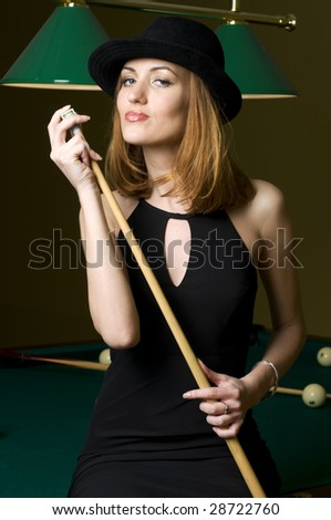 Portrait of the beautiful blonde woman with cue