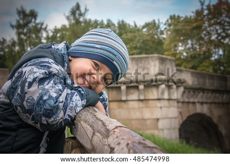 portrait of the beautiful child outdoors, autumn background
