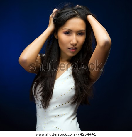 Portrait of the beautiful chinese woman with long hair - stock photo