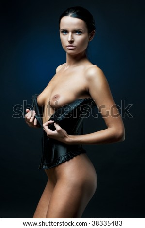 Portrait of the beautiful corseted woman with naked breast - stock photo