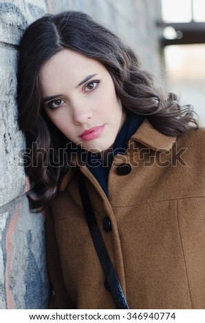 Portrait of the beautiful fashionable girl outdoor on autumn day.