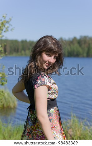Portrait of the beautiful girl in a summer day