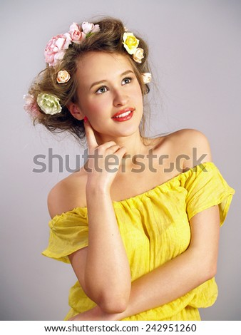 Portrait of the beautiful girl in a yellow dress - stock photo