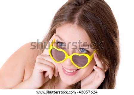 Portrait of the beautiful girl in yellow glasses