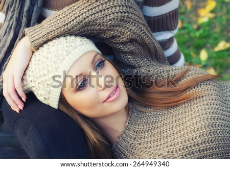 Portrait of the beautiful girl on colorful autumn day. - stock photo